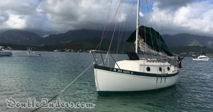 Pacific Sea Craft sailing vessel at anchor under a blue cloudy sky