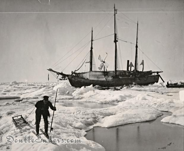 three-masted ship locked in ice with man in the foreground