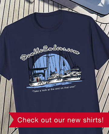 www.doubleenders.com merch advertisement with a t-shirt with logo on it laying on a teak deck and text check out our new shirts