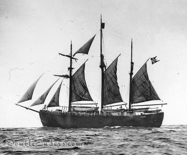 three-masted gaff-rigged ship under sail